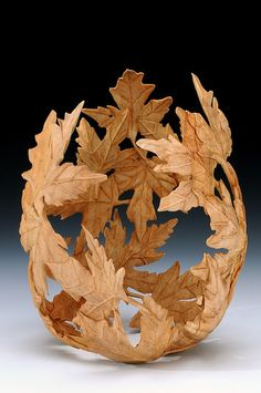 Acer Embrace by Andi Wolfe, 2010. Turned and carved. ca 9 X 7 inches. Elizabeth York collection.
