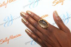 Rockin' an Azaara cocktail ring with golden sparkling nails from Sally Hansen, at Greenwich Jewelers FNO party