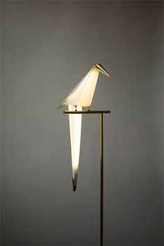 Perch Light  A lamp made out of paper by London based designer Umut Yamac looks like a bird on a metal perch.