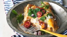 Blogger Cindy Ensley of Hungry Girl por Vida puts a creamy, bacon-filled twist on chicken enchiladas.