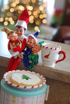 Elf on the Shelf (and friends) with the MAGIC COOKIE they made for us to give to SANTA on Christmas Eve!