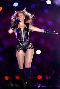 Beyonce at the Superbowl halftime show in a black leather bodysuit by one of her favorite designers, Rubin Singer.