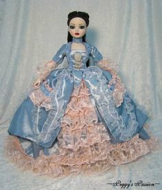 """~Ellowyne's Ball~ 18th Century gown in blue silk taffeta fully lined in white satin. The gown is decorated with yards of handmade pink ruffled lace, organza lace and blue corded trim. The bodice is embellished with a pearled """"brooch"""" and jewels. Closes with snaps. by jerpego via eBay SOLD 11/29/13 (10 bids) $125.00"""