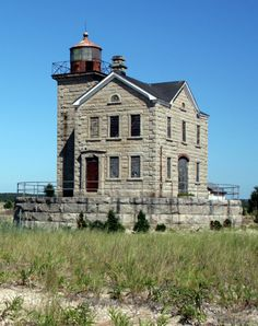 The abandoned Cedar Island Lighthouse in Sag Harbor, NY. Built in 1860, its beacon served to guide whaling ships in and out of Sag Harbor during its heyday as a major port.