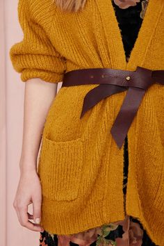 Let's get waisted, ladies. The Ribbon Belt has a ribbon shape and is made in a textured burgundy leather with gold hardware. Adjustable. Super simple, super hot. Perfect to wrap up those open-front coats and cardigans, or to wear with a midi dress. By B-Low the Belt.