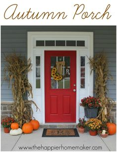 Autumn Porch with corn stalks, mums, and pumpkins...perfect for fall! Love the sunflower wreath too!