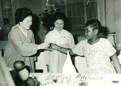 Bizarre childhood: Monique Macias (right) shares a toast with North Korean founder Kim Il-Sung's second wife, Kim Sung-Ae (left), on her fir...