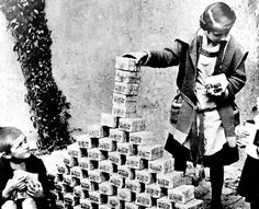 German kids playing with stacks of German Marks in 1923. Due to hyperinflation, this was all probably worth less than $1, Hyperinflation in the Weimar Republic was a three-year period in Germany  between June 1921 and January 1924 when Marks were worth next to nothing.