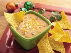 Slow Cooker Nacho Bean Dip -- A perfect edition for the next time you turn on the big game. #Tailgate #Homegate #SlowCooker