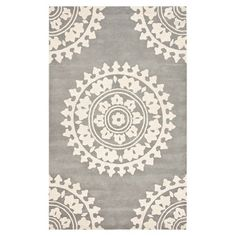 New Zealand wool and art silk rug with a medallion motif. Hand-tufted in India.    Product: RugConstruction Material: