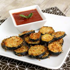 Zucchini Parmesan Crisps  adapted from The Food You Crave by Ellie Krieger (via The Ginger Snap Girl)    1/2 cup grated Parmesan cheese  1/2 cup panko breadcrumbs  1/4 teaspoon salt  freshly ground black pepper   1 lb of zucchini (about 2 medium)  1 tablespoon olive oil  marinara sauce for dipping (optional)