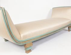 Rare Skyscraper Daybed or Chaise Lounge, designed by Paul Frankl, circa 1930's. Upholstered in an ivory color silk, wooden base finished in it's original green color lacquered and gilt finish.