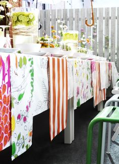 Personalize your wedding celebration with fabric. For a festive DIY tablecloth, try layering panels of different colors and patterns to create your own unique expression.