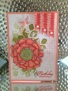 Stampin Up Blended Bloom, Wetlands, Kinda Eclectic stamp sets; Calypso Coral Blendabilities, Calypso Coral Cardstock  Ink, Old Olive Ink, Summer Starfruit Ink, Tim Holtz Faded Dots stencil, Calypso Coral Ribbon, Pearls.