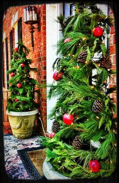 Tomato cage porch trees.     Wrap garland a round tomato cages. Secure with floral wire. Hang pine cones and apples along with lights to decorate.