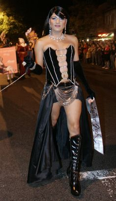 A participant parades down the street before the start of the annual High Heel Drag Race at Dupont Circle in Washington October 30, 2007. The event features drag queens parading in costume before racing down 17th street in the Dupont Circle neighborhood each year on the Tuesday before Halloween.