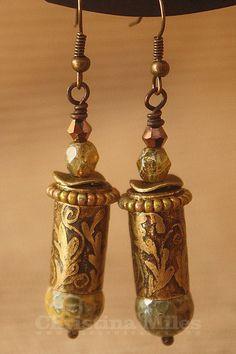 Etched 9mm brass bullet casing earrings.