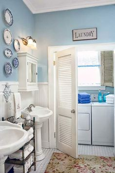 Pale sky-blue walls set off the traditional curves and profiles of the white pedestal sinks, beadboard wainscoting, and crown-molding-topped medicine cabinet to create this Victorian-era style bathroom. | Photo: Eric Roth | thisoldhouse.com laundry bathroom combo, bathroom laundry combo, laundry rooms, door, white bathrooms, bathroom colors 2014, laundry and bathroom combo, bathroom laundry room combo, bathroomlaundri room