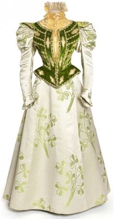 Ok I must have had a past life in France cause I love the cloth from around the end of the 18th century from France Dress (front), French, circa 1897. Satin embroidered with sequins and rhinestones, green cut velvet bodice.