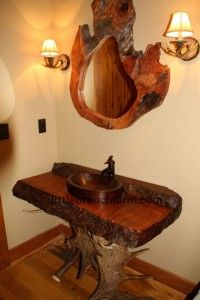 Rustic vanities created from old growth live edge curly redwood. The base is real moose antler sheds. The mirror is a live edge redwood burl