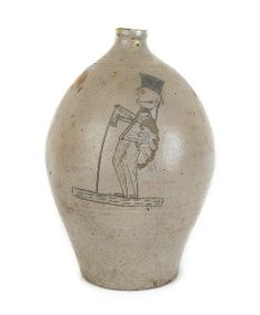 American stoneware jug, early 19th c., probably New York or Connecticut, with an incised and cobalt decorated figure of a gentleman carrying...