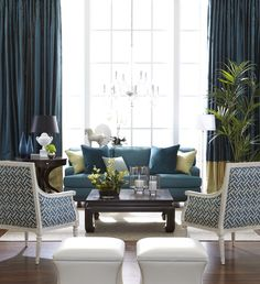 Love everything about this room. Color scheme, 2-tone drapes, sofa, chairs, ottomans...