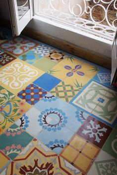 Painted tile floor for laundry room. Stencil on the image and then let the kids paint them.