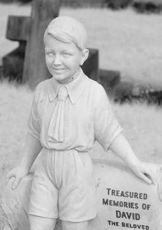 little boy sculpture headstone