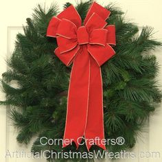Traditional Christmas Wreath - 2013 - Our Traditional Christmas Wreath is made of a full artificial pine wreath base finished with a lovely over-sized bow. It will add a touch of old fashioned Holiday charm! - #ChristmasWreaths #ArtificialChristmasWreaths #TraditionalChristmasWreaths #Wreath #Wreaths