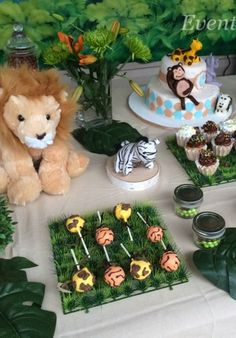 Jungle Themed Baby Shower cake pops and decorations!  See more party planning ideas at CatchMyParty.com!