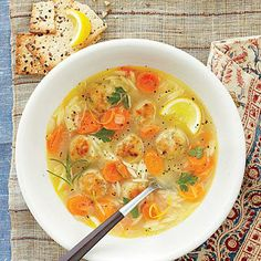 Lemon, Orzo, and Meatball Soup | This hearty twist on chicken noodle soup features small grains of orzo pasta and savory chicken meatballs. | SouthernLiving.com