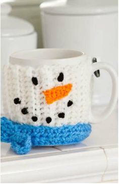 This Christmas crochet idea for coffee and crocheted mug warmers is a fantastic crochet project. The little snowman face is so precious.