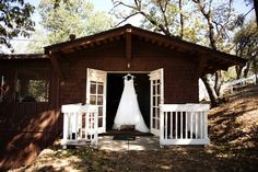 Wedding Dress Hanging From A Cabin At The Pine Hills Lodge