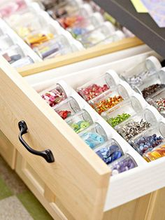 Group tiny buttons and brads in small clear jars, then pop them in a spice-drawer organizer for the perfect mini storage solution.
