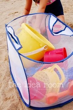 Use a mesh laundry pop-up bag for beach toys, and keep the sand where it belongs. Good tip to use talk/ baby powder to get off wet sand from skin.