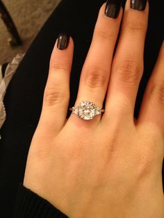 3 carat, 3 stone diamond engagement ring! So sparkly! Gorgeous, but I wouldn't want something that huge.