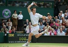 Andy Murray blasts a forehand back at six-times champion Roger Federer during the tense first set