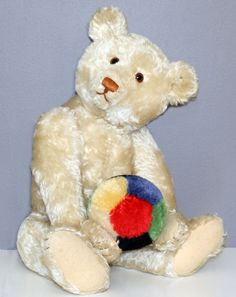 Wonderful Antique White Steiff Teddy with Steiff ball in excellent condition.   Photo via web....