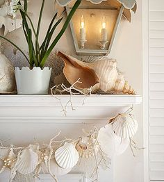 Celebrate summer by bringing in summery beach theme elements to your decor. Lovely garland of white seashells. BHG