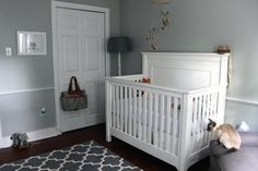 Gender neutral nursery with gray and white colors