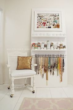 Gorgeous jewelry storage. Earrings on a mesh screen inside a frame, bracelets stacked on the necks of bottles and vases, and necklaces hung on S-hooks from a curtain rod.