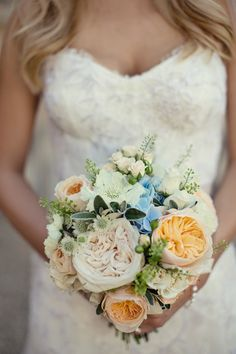 Beautiful bridal bouquet with peach, blue, ivory and green, photos by Marianne Taylor | via junebugweddings.com
