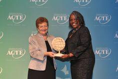 Arjonetta Gailyard accepts the 2014 ACTE Award of Merit on behalf of Joerg Klisch, Vice President of North American Operations for Tognum America.