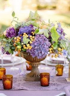 purple and yellow wedding floral centerpiece