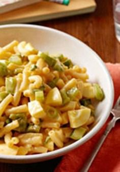 Cheesy Macaroni Salad -- Ready to refrigerate in just 15 minutes, this recipe is sure to be a crowd favorite at your next get-together.