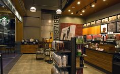 The store design seen here is a throwback to the history of shipping and aeronautics in the Portland area. Taking advantage of its height, the two-story location has the look and feel of a flight hangar.