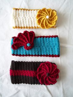 crochet headbands. Crochet headbands I made for my sisters. More pictures and a link to the pattern can be found here: http://www.ravelry.com/projects/arnyhekla/valentine-romance-headband-6