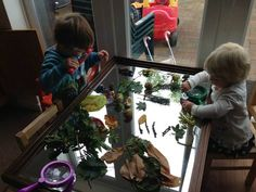 Lovely set up on mirror for Investigating  -Cathy's Childminding