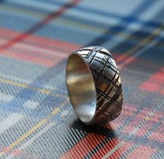 Here's a unique ring for the groom. Plaid