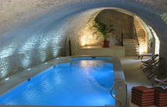 "Indoor swimming pool. I love the ""cave style look"" to it.."